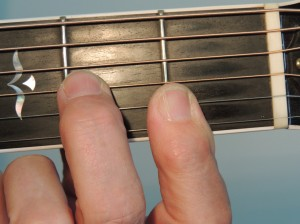 How to teach barre guitar chords - Dm7 partial barre chords